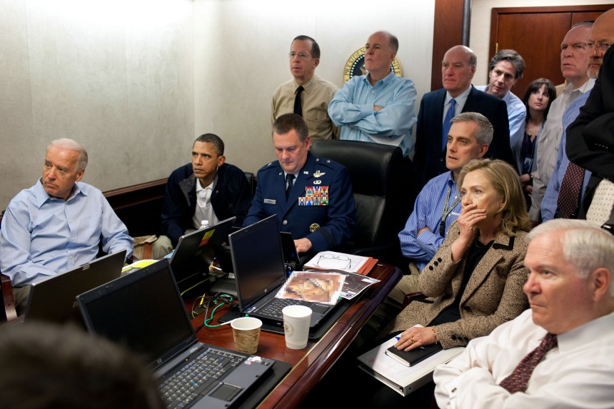 President Barack Obama and Vice President Joe Biden, along with with members of the national security team, receive an update on the mission against Osama bin Laden in the Situation Room of the White House, May 1, 2011. Please note: a classified document seen in this photograph has been obscured. (Official White House Photo by Pete Souza) This official White House photograph is being made available only for publication by news organizations and/or for personal use printing by the subject(s) of the photograph. The photograph may not be manipulated in any way and may not be used in commercial or political materials, advertisements, emails, products, promotions that in any way suggests approval or endorsement of the President, the First Family, or the White House.