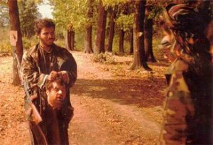 Photo of Saudi Arab IslamistTerrorists beheading Serbs in Bosnia, 1992.1